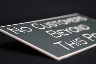 What are engraved signs commonly used for?