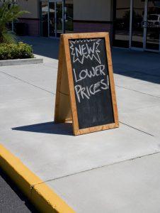 sandwich sign on sidewalk